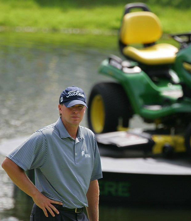 Steve Stricker waits to play on the 18th green during the continuation of the second round of the John Deere Classic.