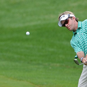 Brett Quigley plays his second shot on the 14th hole during the final round of the John Deere Classic at TPC Deere Run.