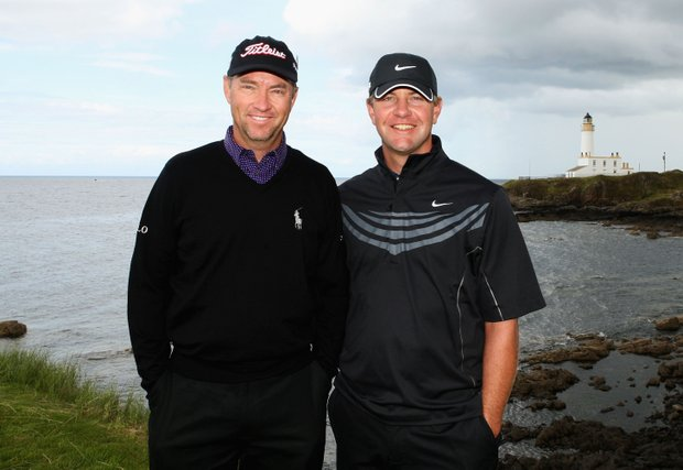Davis Love III and Lucas Glover (R) pose for a photo during a practice round prior to the 138th Open Championship.