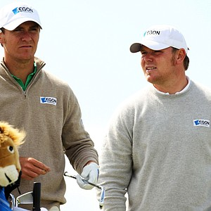 "Scotland's Elliot Saltman (left) had been under a cloud since he was accused of ""cheating"" on the 2010 Challenge Tour. He got his card at Euro Q-School but might not get full use of it. He was banned for 3 months on Wednesday. Saltman is seen here with his brother, Lloyd."