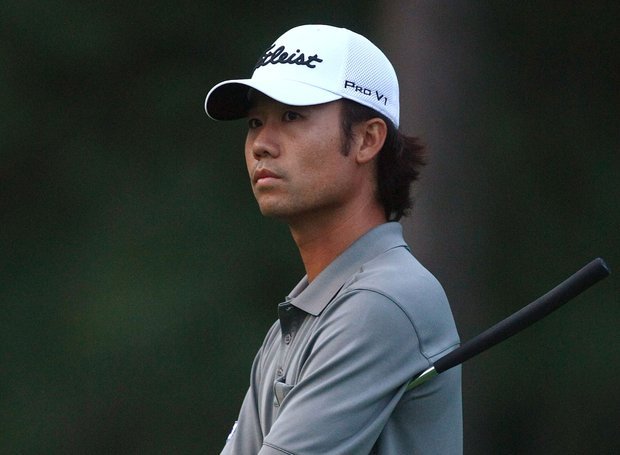 Kevin Na waits to putt on the ninth green during round one of the RBC Canadian Open at Glen Abbey Golf Club.