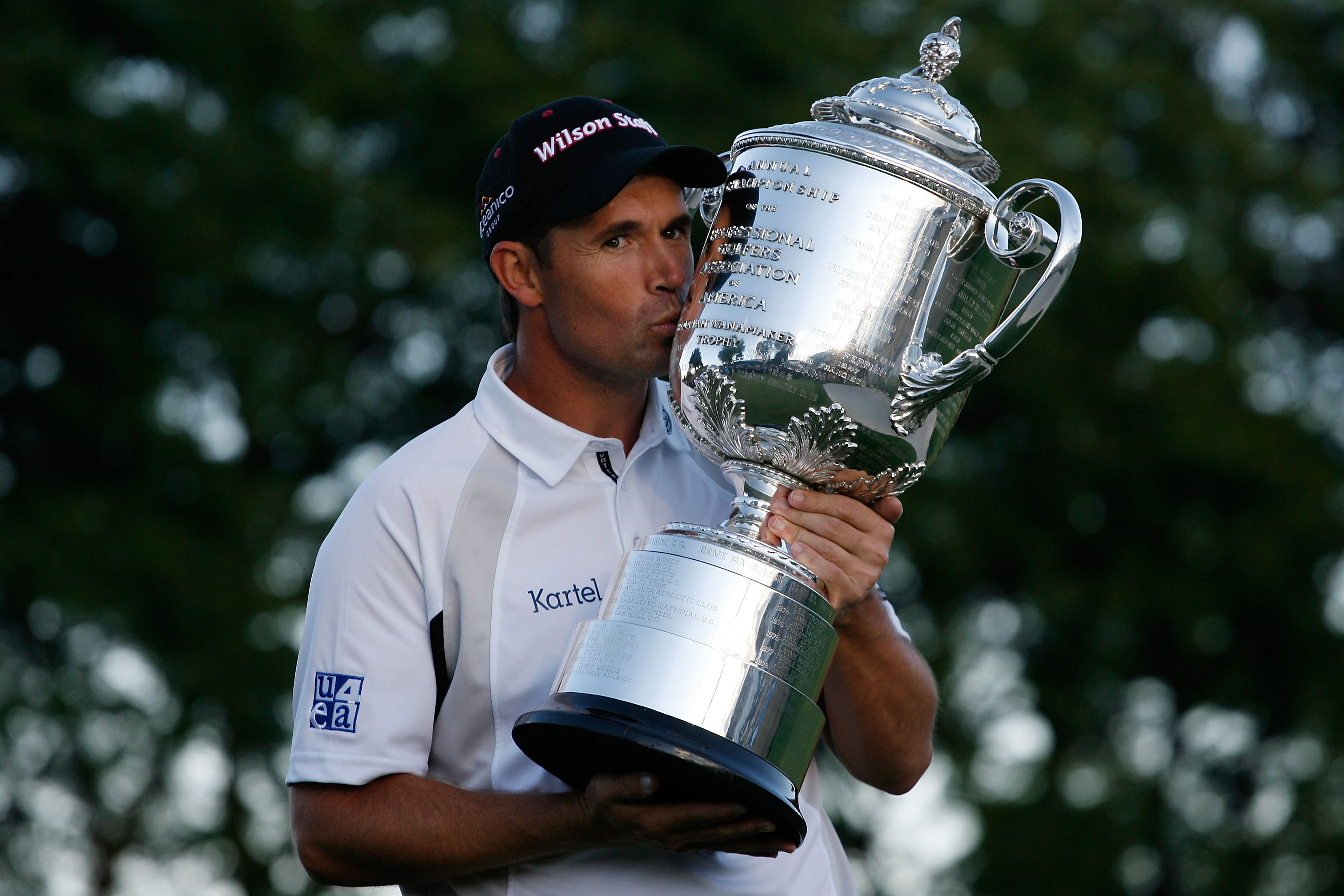 Padraig Harrington of Ireland celebrates his win while kissing the PGA Championship Trophy after winning the 90th PGA Championship at Oakland Hills Country Club.