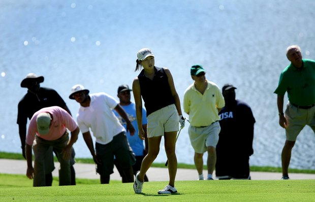 St. Louis, MO--08/09/09--Jennifer Song watches her second shot at no. 14 during the finals of the 109th U. S. Women's Amateur Championship at Old Warson Country Club in St. Louis, MO.--(Photo by Tracy Wilcox/GOLFWEEK)
