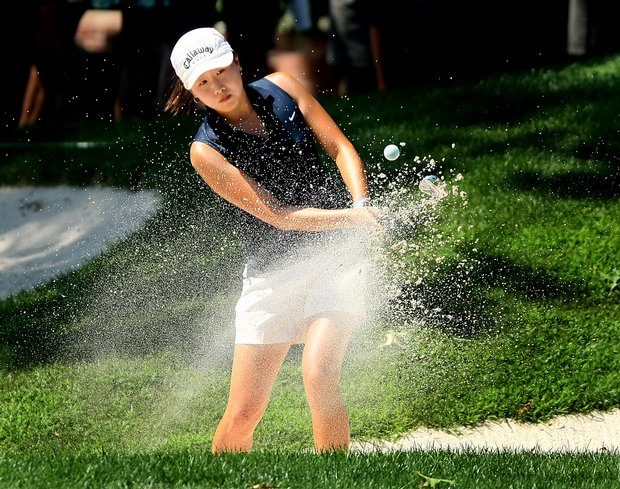 St. Louis, MO--08/09/09--Jennifer Song hits out of the greenside bunker at no. 18 during the first 18 holes of the finals of the 109th U. S. Women's Amateur Championship at Old Warson Country Club in St. Louis, MO.--(Photo by Tracy Wilcox/GOLFWEEK)
