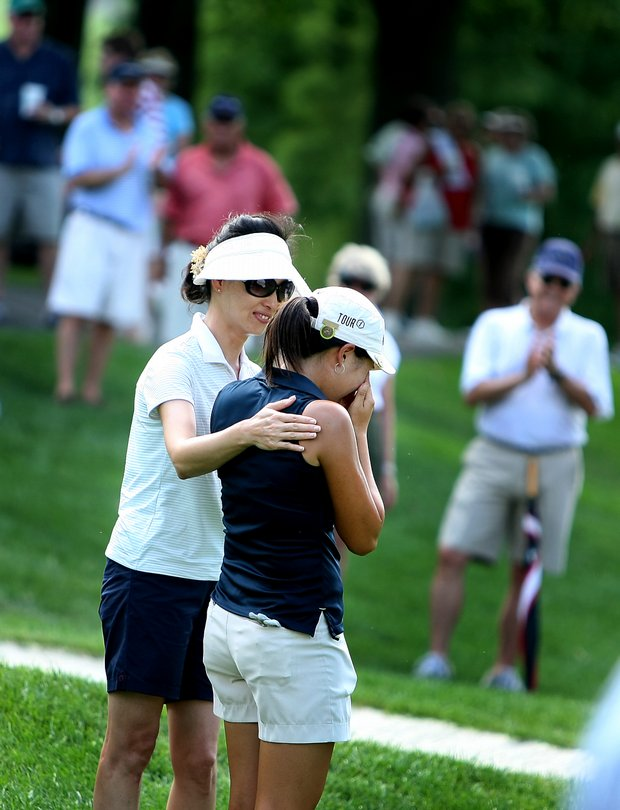 St. Louis, MO--08/09/09--Jennifer Song is congratulated by her mother, Jee Yeon Koong, after she won the 109th U. S. Women's Amateur Championship at Old Warson Country Club in St. Louis, MO.--(Photo by Tracy Wilcox/GOLFWEEK)