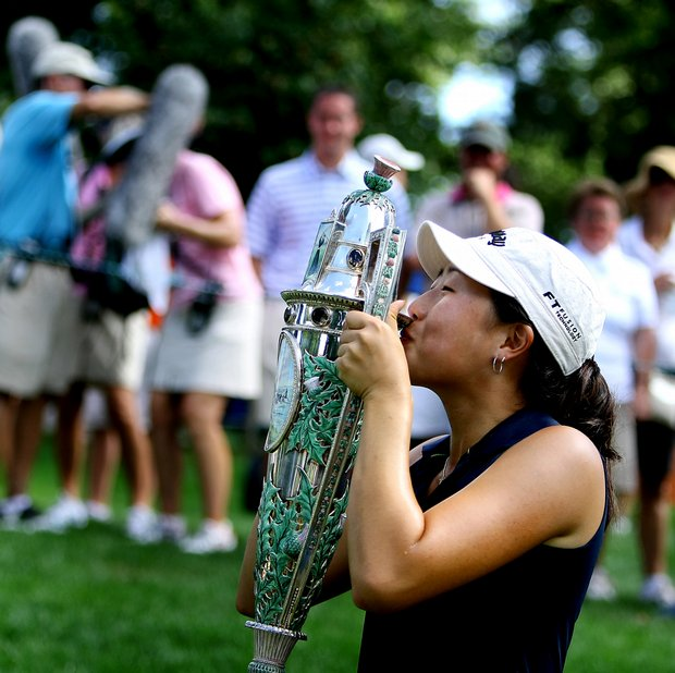 St. Louis, MO--08/09/09--Jennifer Song kisses the Robert Cox Cup on the 17th green were she was presented with the trophy after winning the 109th U. S. Women's Amateur Championship at Old Warson Country Club in St. Louis, MO.--(Photo by Tracy Wilcox/GOLFWEEK)