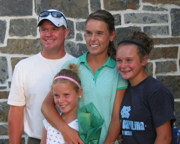 Joanne Steele stands with her husband and two daughters after winning her second Montana Women's State Amateur title.