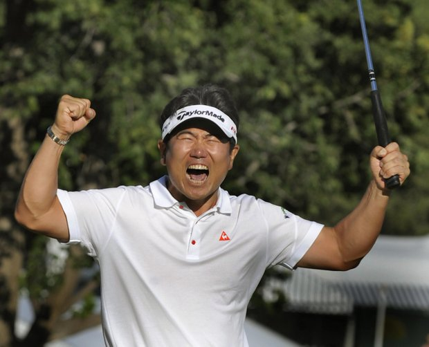 Y.E. Yang reacts after winning the PGA Championship at the Hazeltine National Golf Club.