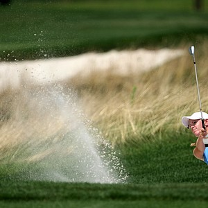 Amy Anderson blasts out of a greenside bunker at no. 6.