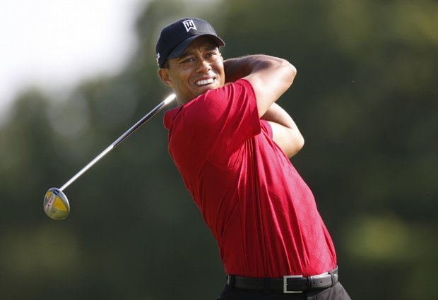 Tiger Woods tees off at the Buick Open.