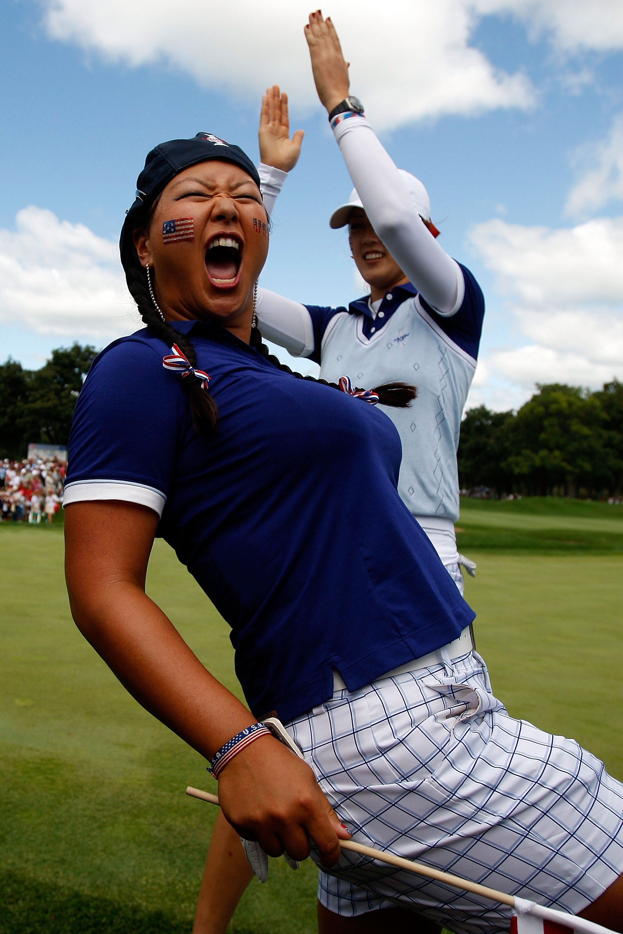 Christina Kim celebrates during the Saturday morning fourball matches at the Solheim Cup.
