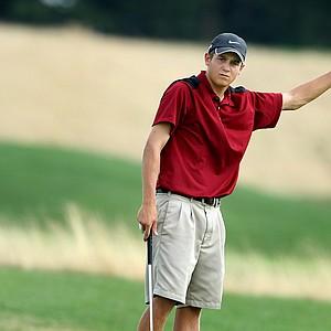 Logan Harrell reacts to his putt at no. 17.