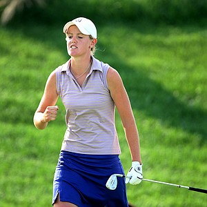 Amy Anderson pumps her fist after chipping in at no. 18.