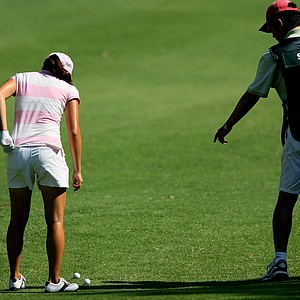 Jennifer Song looks to see which ball is hers in the 4th fairway.