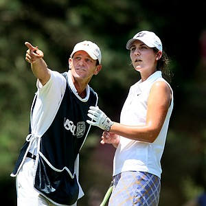 Jennifer Johnson with her caddie Steve Ries at no. 13.