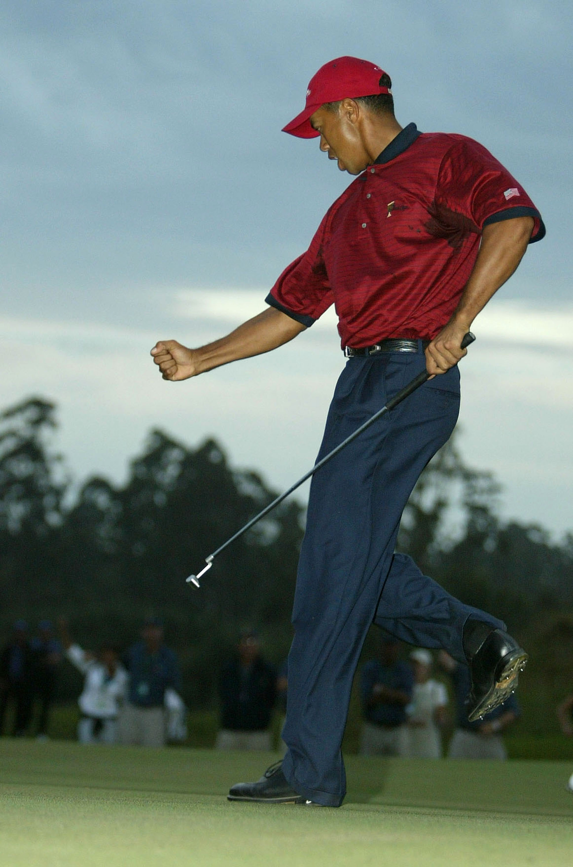 Tiger Woods celebrates a par-saving putt in a playoff against Ernie Els at the 2003 Presidents Cup.