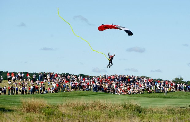 A skydiver lands on the first fairway.