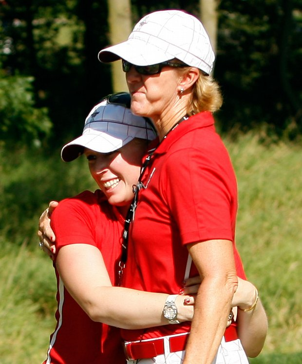 Morgan Pressel hugs U.S. captain Beth Daniel.