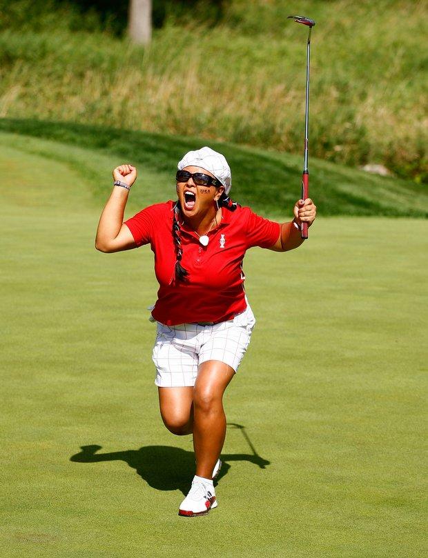 Christina Kim celebrates after a making a putt.