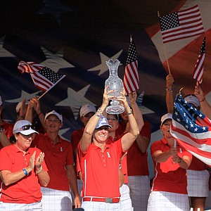 U.S. captain Beth Daniel hoists the Solheim Cup.