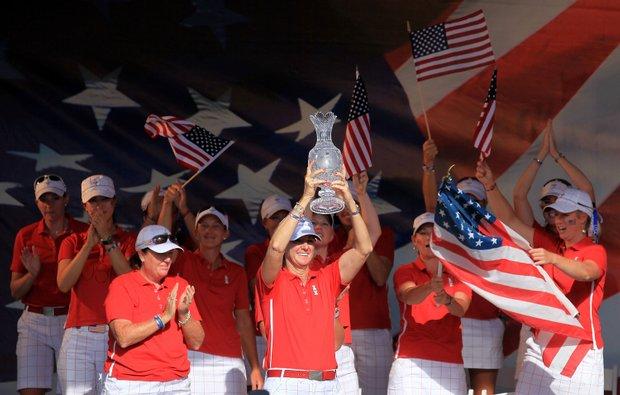 U.S. captain Beth Daniel hoists the Solheim Cup.