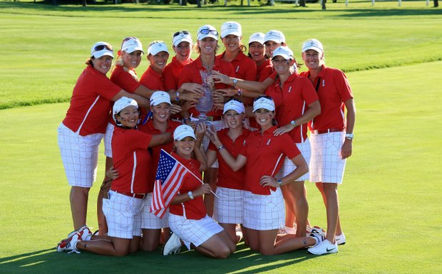 Team USA poses with the Solheim Cup.