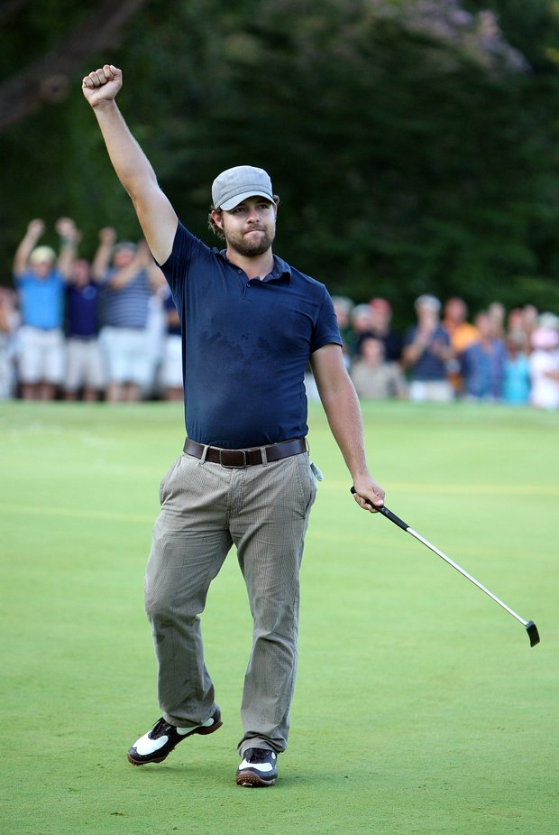 Ryan Moore celebrates his victory at the Wyndham Championship.