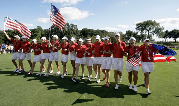 Team USA celebrates its Solheim Cup victory at Rich Harvest Farms. The Americans topped Europe 16-12 to retain the cup.