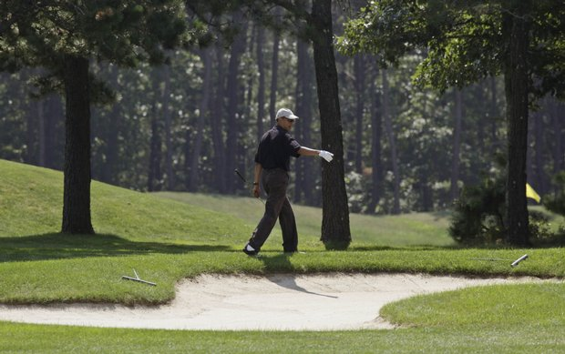 President Barack Obama plays golf during his vacation on Martha's Vineyard.
