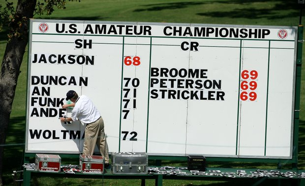 Low scores are posted near the 18th green.