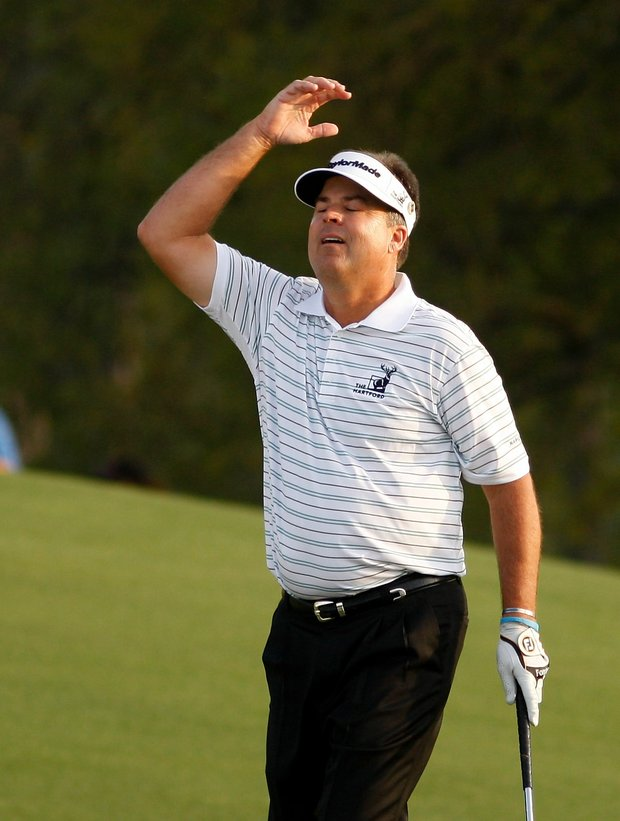 Kenny Perry reacts after a missed putt on the 18th green during the final round of the 2009 Masters.