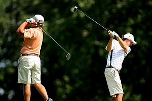 Fletcher Johnson, left, and Jordan Spieth, right, practice their swing on the 13th tee.
