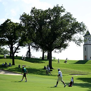 Players walk up the fourth fairway during Tuesday stroke play.