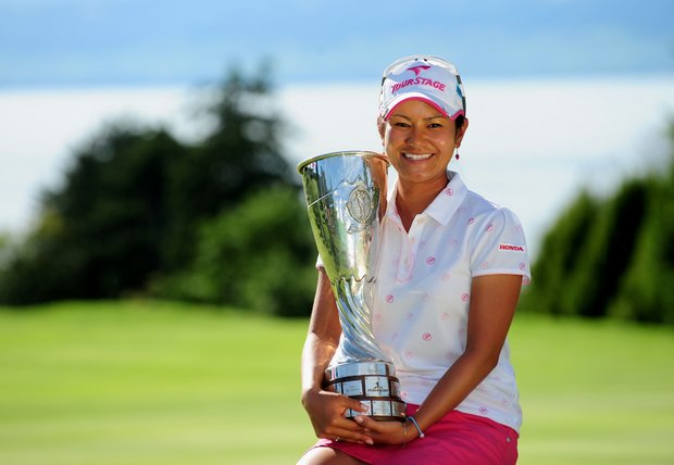 Ai Miyazato of Japan poses with the trophy after winning in a playoff at the Evian Masters.