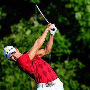 Camilo Villegas of Colombia hits his tee shot on the 10th hole during the first round of the 91st PGA Championship at Hazeltine National Golf Club.