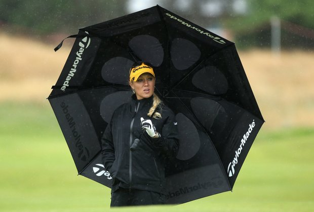 atalie Gulbis of USA shelters under an umbrella during the Pro-Am prior to the 2009 Ricoh Women's British Open Championship held at Royal Lytham St Annes Golf Club