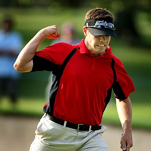 Brenton Flynn reacts to making a birdie on the first playoff hole.