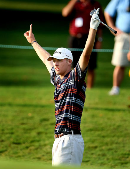Tyson Alexander celebrates after chipping in for birdie on the first playoff hole Aug. 26 to advance to match play at the U.S. Amateur.