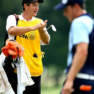 Alan Bratton, assistant coach at Oklahoma State, tries to get some applause for his player, Peter Uihlein at No. 9.