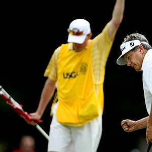 Tim Jackson and his caddie Frank Billings celebrate winning No. 17 to extend the match.