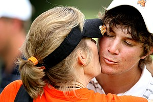 Peter Uihlein gets a kiss from his mother, Tina, after winning his match.