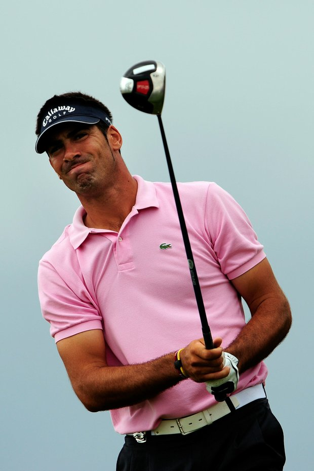 Alvaro Quiros of Spain watches his tee shot on the first hole during the final round of the 91st PGA Championship.