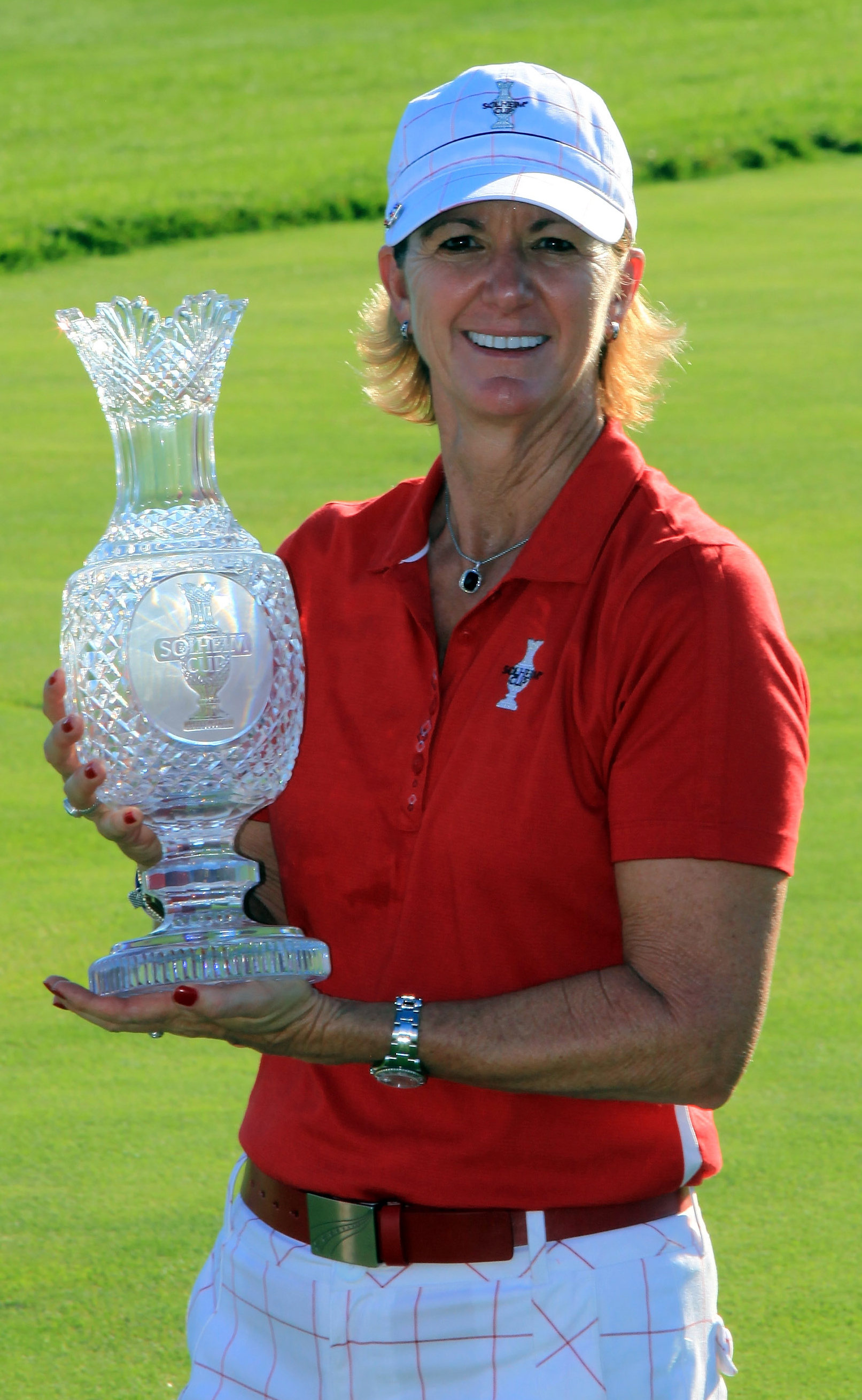 Beth Daniel displays the Solheim Cup and her feisty red fingernails.