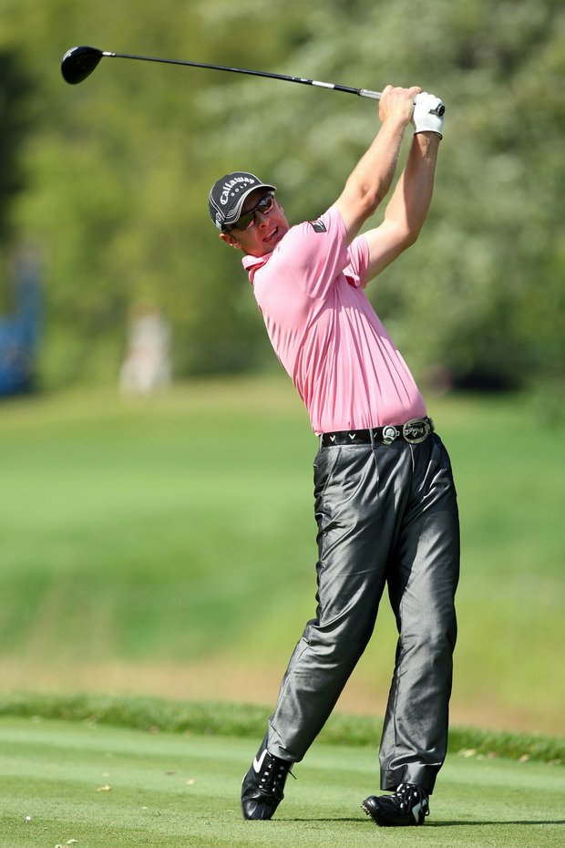 Brendan Jones of Australia watches his tee shot on the 12th hole during the final round of the 91st PGA Championship.