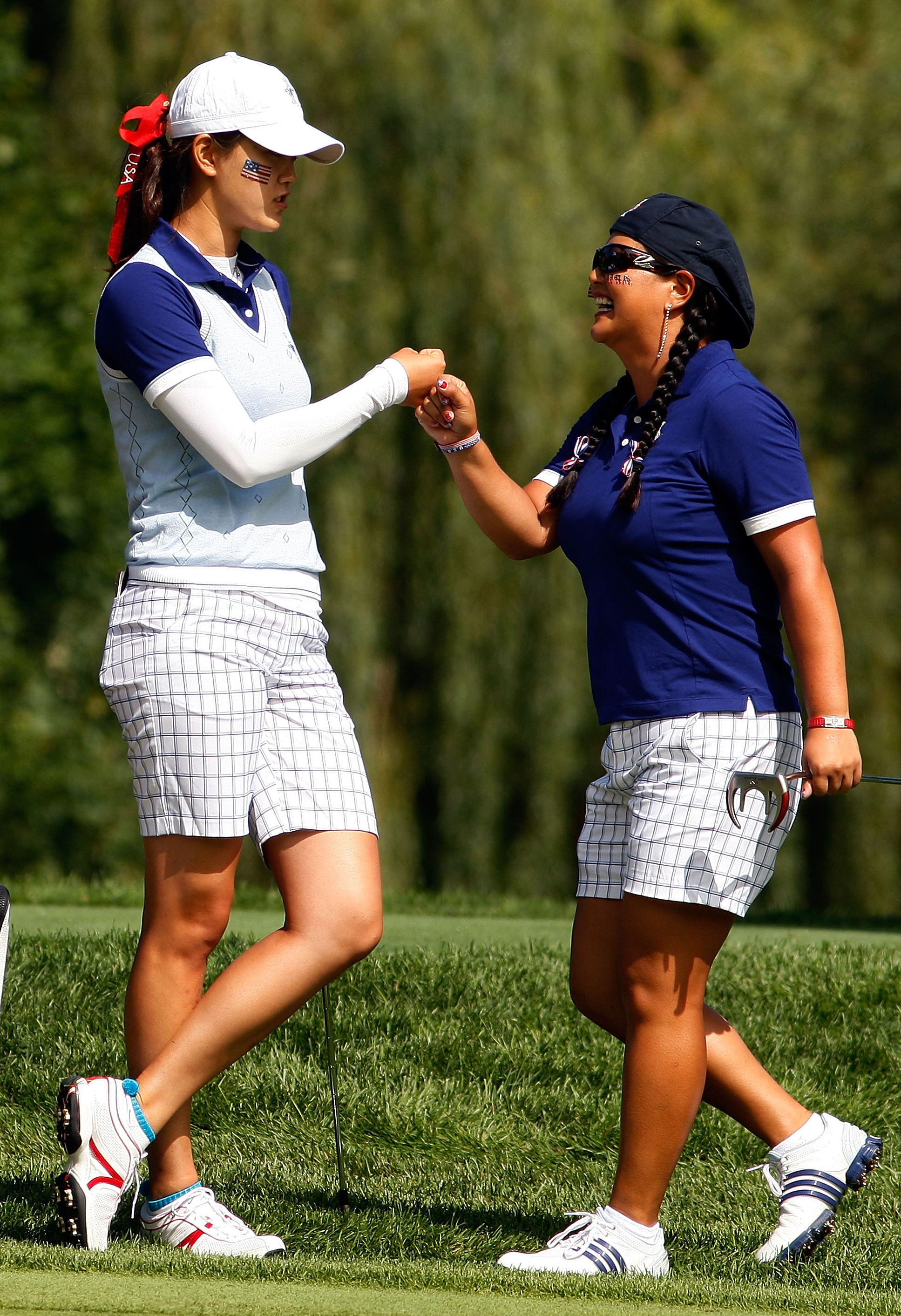 Michelle Wie and Christina Kim sport blue outfits at the Solheim Cup.