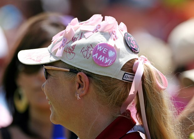 A tournament volunteer wears pink ribbons and a 'We Love Amy' button on her hat to show her support for Amy Mickelson and breast cancer research during the third round of the Crowne Plaza Invitational at Colonial Country Club.