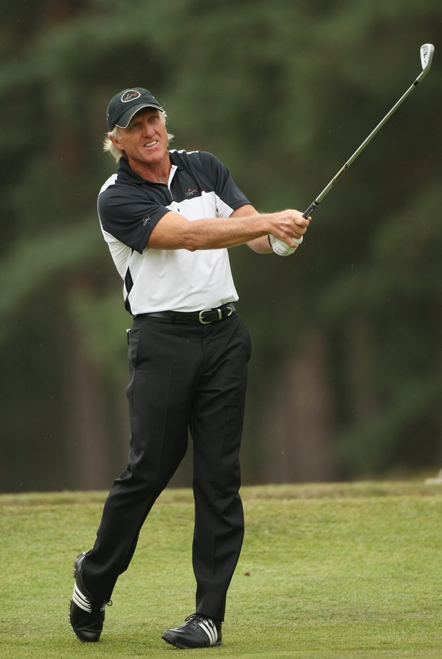 Greg Norman of Australia plays his second shot into the second green during the final round of The Senior Open Championship.