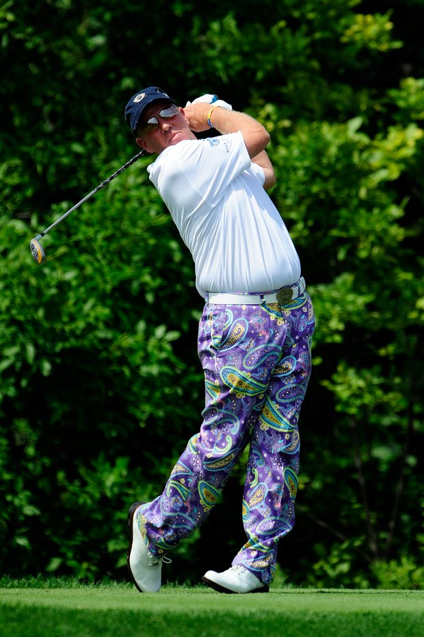 John Daly plays his tee shot on the 10th hole during the first round.