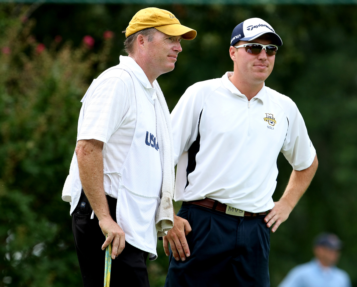 Mike Van Sickle and his father/caddie, Gary, hang out Thursday at the U.S. Amateur.
