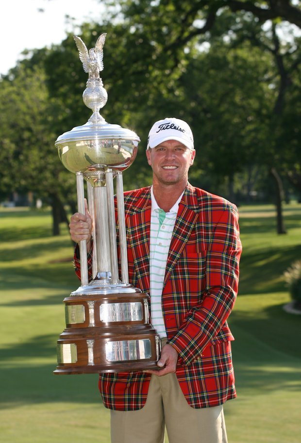 Steve Stricker holds the championship trophy after winning the Crowne Plaza Invitational at Colonial Country Club.